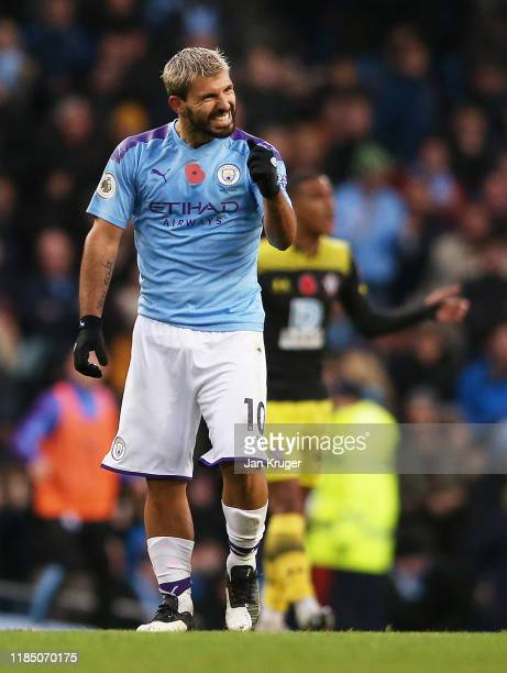 Sergio Aguero of Manchester City celebrates after scoring his team's first goal during the Premier League match between Manchester City and...