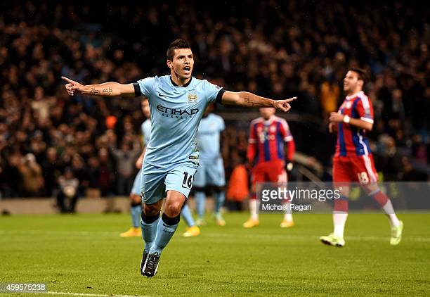 Sergio Aguero of Manchester City celebrates after scoring the opening goal from the penalty spot during the UEFA Champions League Group E match...