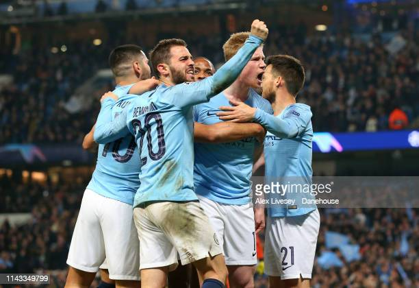 Sergio Aguero of Manchester City celebrates after scoring their fourth goal with Kevin De Bruyne and team mates during the UEFA Champions League...