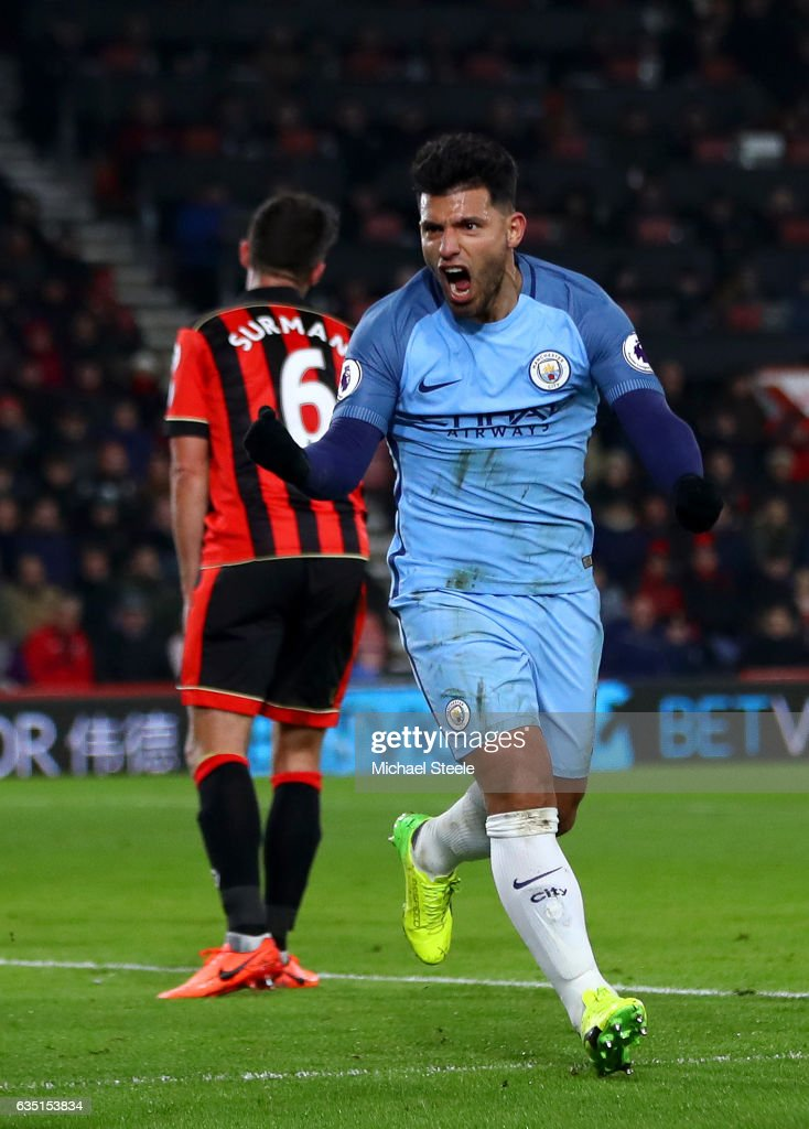 Sergio Aguero of Manchester City celebrates after sliding in next to Tyrone Mings of Bournemouth to score his team's second goal during the Premier League match between AFC Bournemouth and Manchester City at Vitality Stadium on February 13, 2017 in Bournemouth, England.