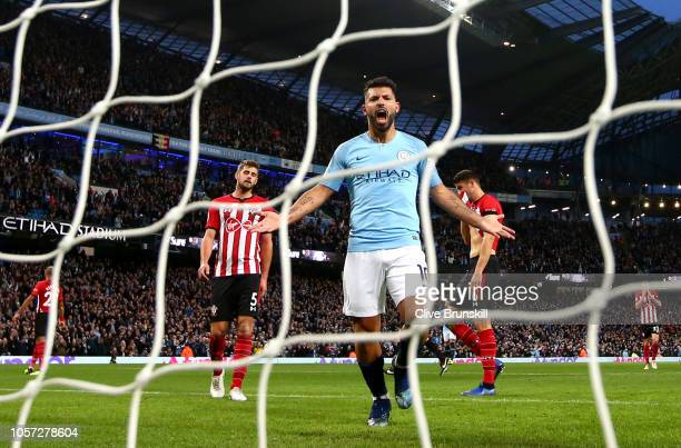 Sergio Aguero of Manchester City celebrates after teammate Raheem Sterling scores their team's fifth goal during the Premier League match between...