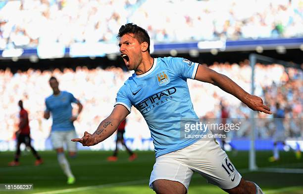 Sergio Aguero of Manchester City celebrates as he scores their first goal during the Barclays Premier League match between Manchester City and...