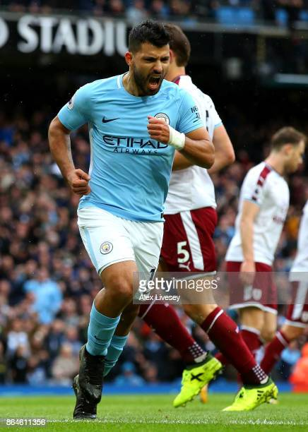 Sergio Aguero of Manchester City celebrates as he scores their first goal from the penalty spot during the Premier League match between Manchester...