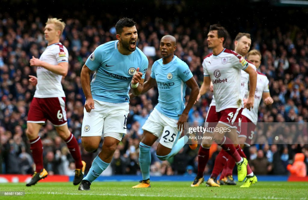 Sergio Aguero of Manchester City celebrates as he scores their first goal from the penalty spot during the Premier League match between Manchester City and Burnley at Etihad Stadium on October 21, 2017 in Manchester, England.