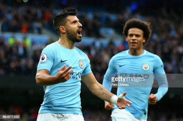Sergio Aguero of Manchester City celebrates as he scores their first goal from the penalty spot with Leroy Sane of Manchester City during the Premier...