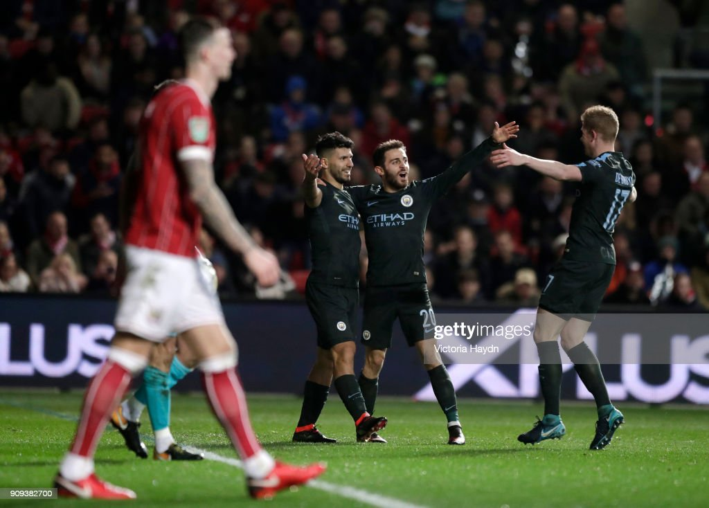 Sergio Aguero of Manchester City (2L) celebrates as he scores their second goal with Bernardo Silva and Kevin De Bruyne during the Carabao Cup semi-final second leg match between Bristol City and Manchester City at Ashton Gate on January 23, 2018 in Bristol, England.