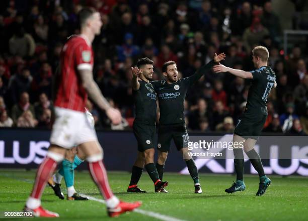 Sergio Aguero of Manchester City celebrates as he scores their second goal with Bernardo Silva and Kevin De Bruyne during the Carabao Cup semi-final...
