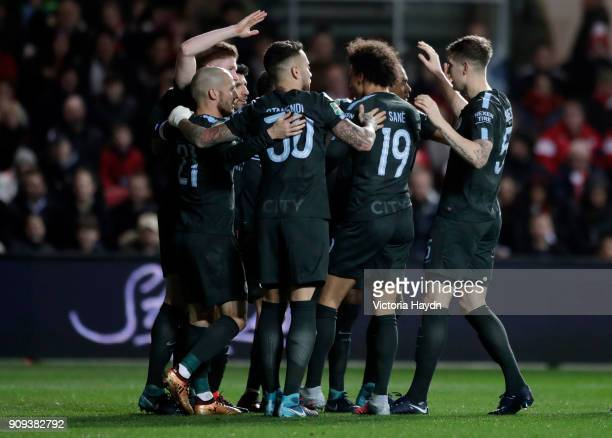 Sergio Aguero of Manchester City celebrates as he scores their second goal with team mates during the Carabao Cup semifinal second leg match between...