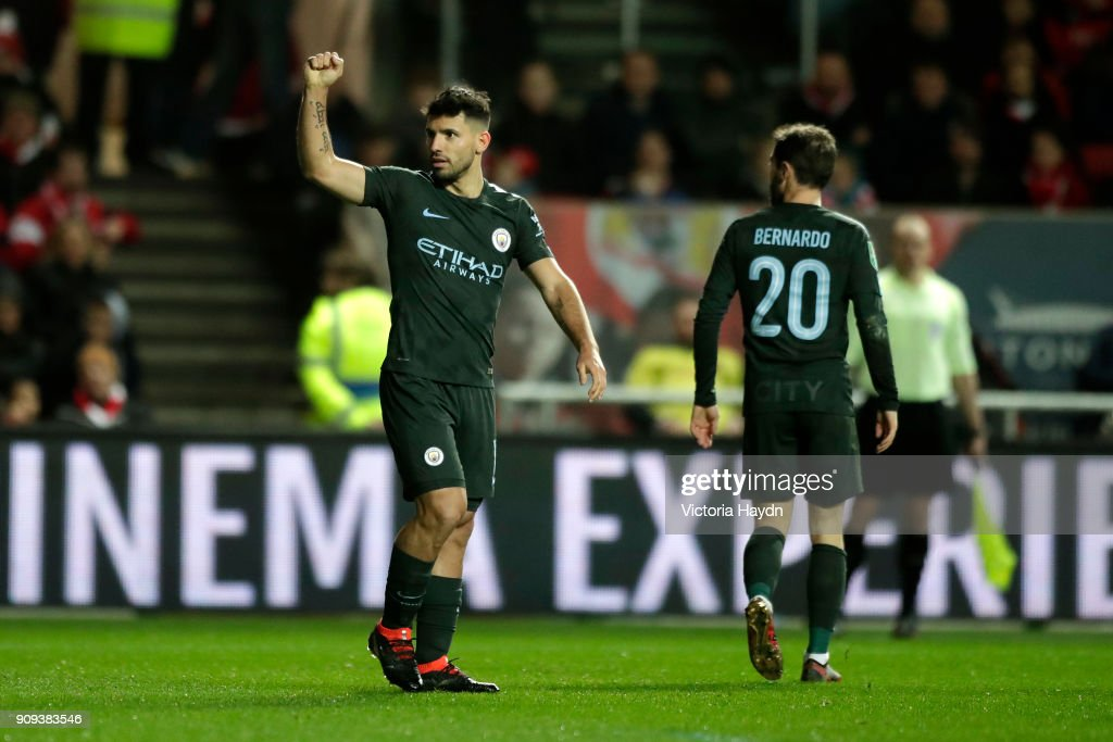 Sergio Aguero of Manchester City (L) celebrates as he scores their second goal with Bernardo Silva during the Carabao Cup semi-final second leg match between Bristol City and Manchester City at Ashton Gate on January 23, 2018 in Bristol, England.