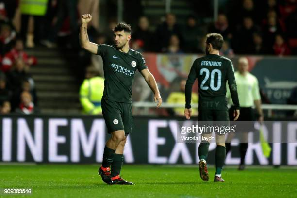 Sergio Aguero of Manchester City celebrates as he scores their second goal with Bernardo Silva during the Carabao Cup semifinal second leg match...