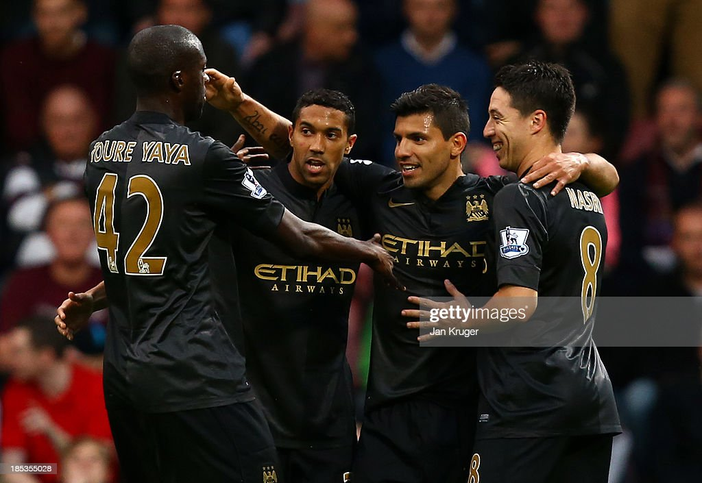 Sergio Aguero of Manchester City(2R) celebrates his opening goal with team mates during the Barclays Premier League match between West Ham United and Manchester City at the Boleyn Ground on October 19, 2013 in London, England.