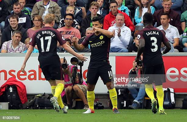 Sergio Aguero of Manchester City celebrates his opening goal with team mates Kevin De Bruyne and Bacary Sagna during the Premier League match between...