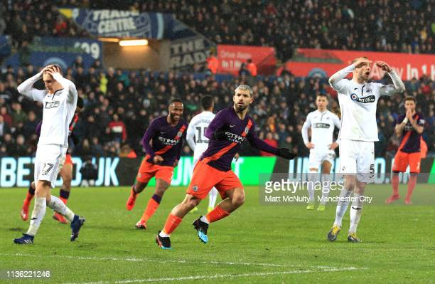 Sergio Aguero of Manchester City celebrates his team's second goal which rebounds off Kristoffer Nordfeldt of Swansea City for an own goal during the...