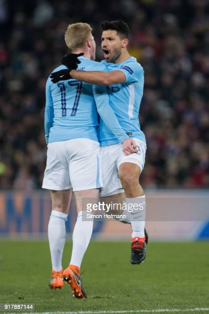 Sergio Aguero of Manchester City celebrates his team's third goal with team mate Kevin De Bruyne during the UEFA Champions League Round of 16 First...