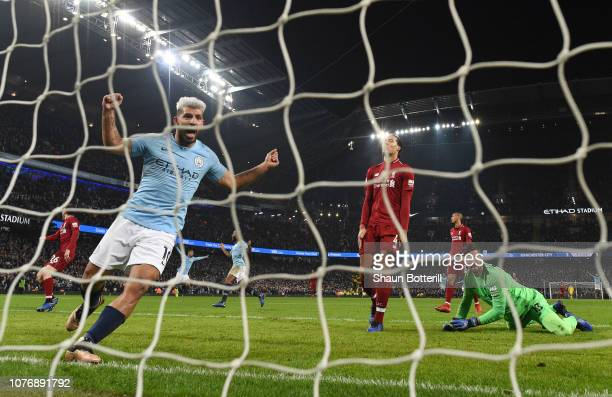 Sergio Aguero of Manchester City celebrates hsi sides second goal as Virgil van Dijk of Liverpool and Alisson of Liverpool react during the Premier...