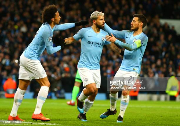 Sergio Aguero of Manchester City celebrates scoring a penalty to make it 10 with David Silva and Leroy Sane of Manchester City during the UEFA...
