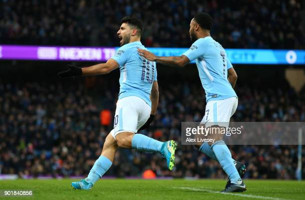 Sergio Aguero of Manchester City celebrates scoring his first goal with Raheem Sterling during The Emirates FA Cup Third Round match between...