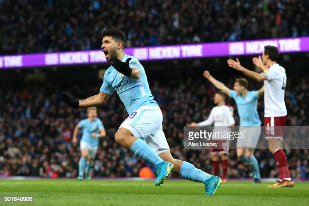 Sergio Aguero of Manchester City celebrates scoring his first goal during The Emirates FA Cup Third Round match between Manchester City and Burnley...