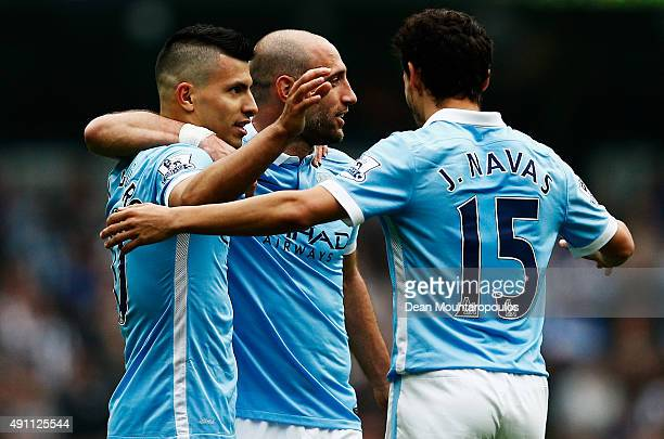 Sergio Aguero of Manchester City celebrates scoring his fourth and team's fifth goal with his team mates Pablo Zabaleta and Jesus Navas during the...