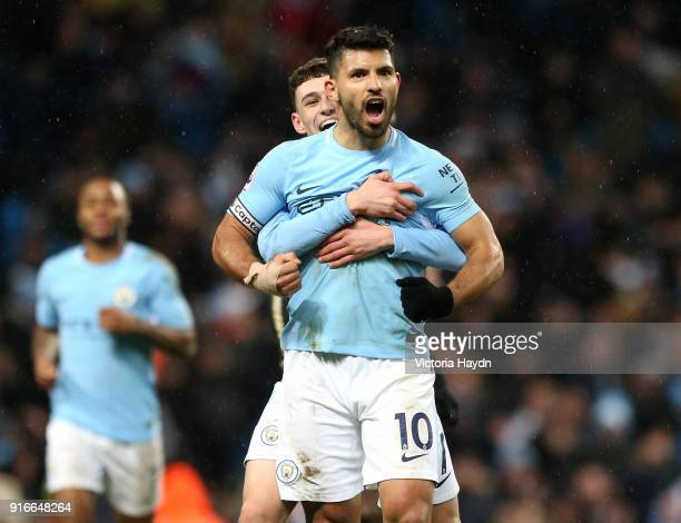 Sergio Aguero of Manchester City celebrates scoring his fourth goal his side's fifth whilst being embraced by Phil Foden during the Premier League...