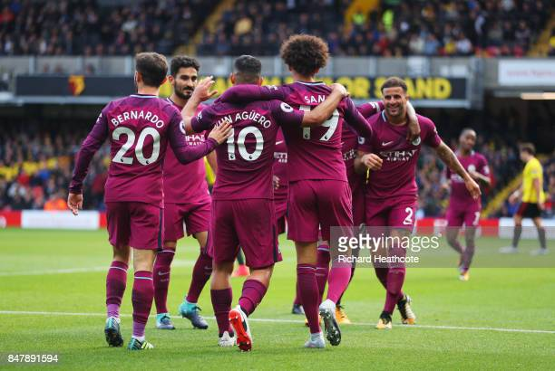 Sergio Aguero of Manchester City celebrates scoring his sides fifth goal with his Manchester City team mates during the Premier League match between...