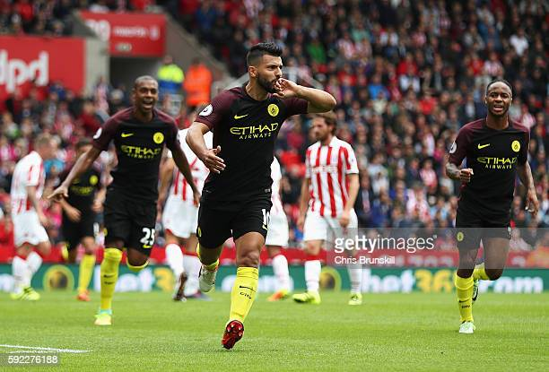 Sergio Aguero of Manchester City celebrates scoring his sides first goal during the Premier League match between Stoke City and Manchester City at...
