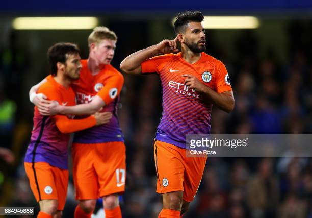 Sergio Aguero of Manchester City celebrates scoring his sides first goal during the Premier League match between Chelsea and Manchester City at...