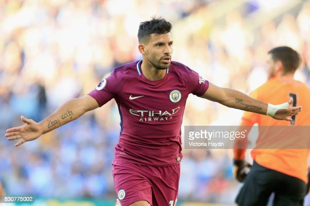 Sergio Aguero of Manchester City celebrates scoring his sides first goal during the Premier League match between Brighton and Hove Albion and...