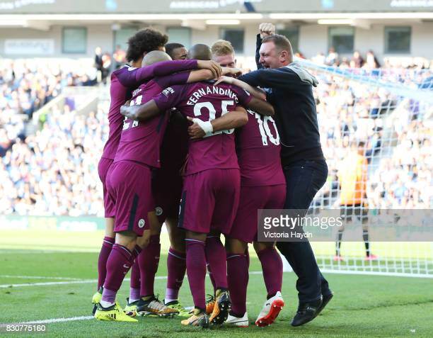 Sergio Aguero of Manchester City celebrates scoring his sides first goal with his Manchester City team mates during the Premier League match between...