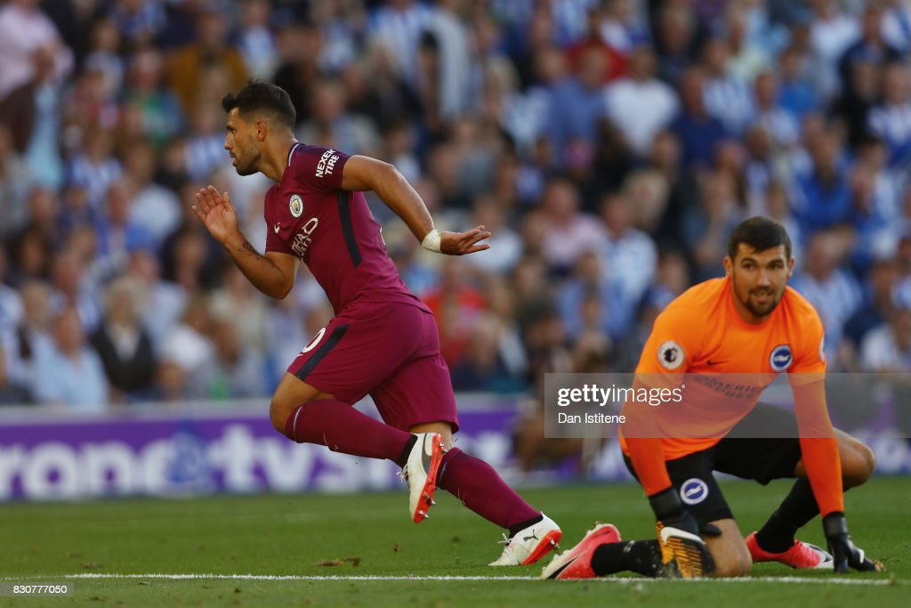 Sergio Aguero of Manchester City celebrates scoring his sides first goal during the Premier League match between Brighton and Hove Albion and Manchester City at the Amex Stadium on August 12, 2017 in Brighton, England.