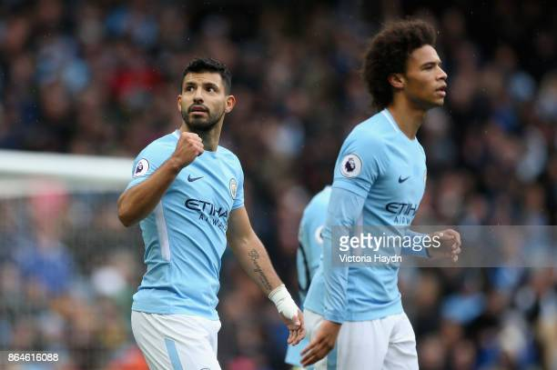 Sergio Aguero of Manchester City celebrates scoring his side's first goal during the Premier League match between Manchester City and Burnley at...