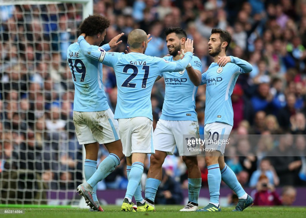 Sergio Aguero of Manchester City celebrates scoring his sides fourth goal with his Manchester City team mates during the Premier League match between Manchester City and Crystal Palace at Etihad Stadium on September 23, 2017 in Manchester, England.
