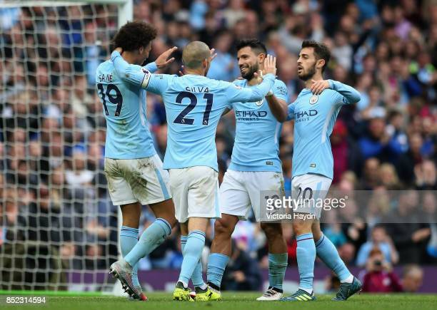 Sergio Aguero of Manchester City celebrates scoring his sides fourth goal with his Manchester City team mates during the Premier League match between...