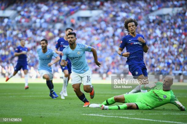 Sergio Aguero of Manchester City celebrates scoring his side's second goal past Willy Caballero of Chelsea during the FA Community Shield between...
