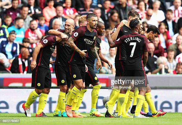 Sergio Aguero of Manchester City celebrates scoring his sides second goal with his team mates during the Premier League match between Stoke City and...