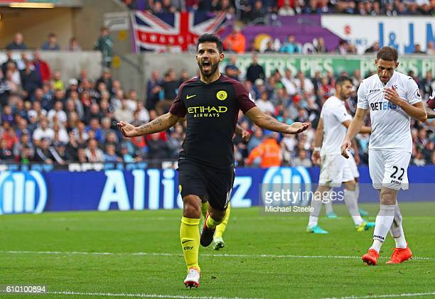 Sergio Aguero of Manchester City celebrates scoring his sides second goal during the Premier League match between Swansea City and Manchester City at...