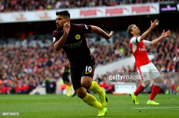 Sergio Aguero of Manchester City celebrates scoring his sides second goal during the Premier League match between Arsenal and Manchester City at...