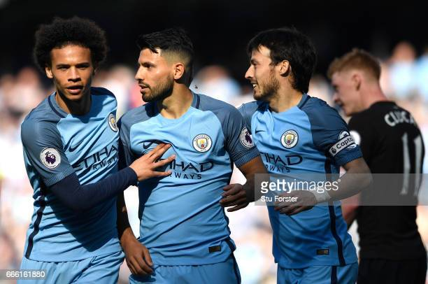 Sergio Aguero of Manchester City celebrates scoring his sides second goal with Leroy Sane of Manchester City and David Silva of Manchester City...
