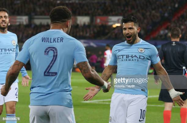Sergio Aguero of Manchester City celebrates scoring his sides second goal with Kyle Walker of Manchester City during the UEFA Champions League group...