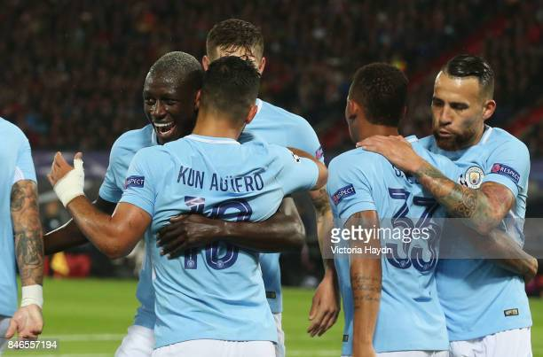 Sergio Aguero of Manchester City celebrates scoring his sides second goal with his Manchester City team mates during the UEFA Champions League group...