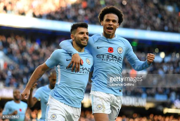Sergio Aguero of Manchester City celebrates scoring his sides second goal with Leroy Sane of Manchester City during the Premier League match between...