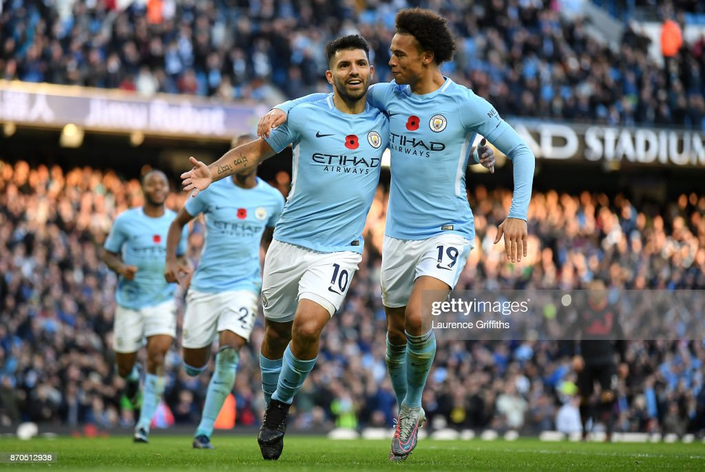 Sergio Aguero of Manchester City celebrates scoring his sides second goal with Leroy Sane of Manchester City during the Premier League match between Manchester City and Arsenal at Etihad Stadium on November 5, 2017 in Manchester, England.