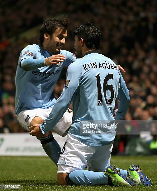 Sergio Aguero of Manchester City celebrates scoring his side's third goal with team mate David Silva during the Barclays Premier League match between...