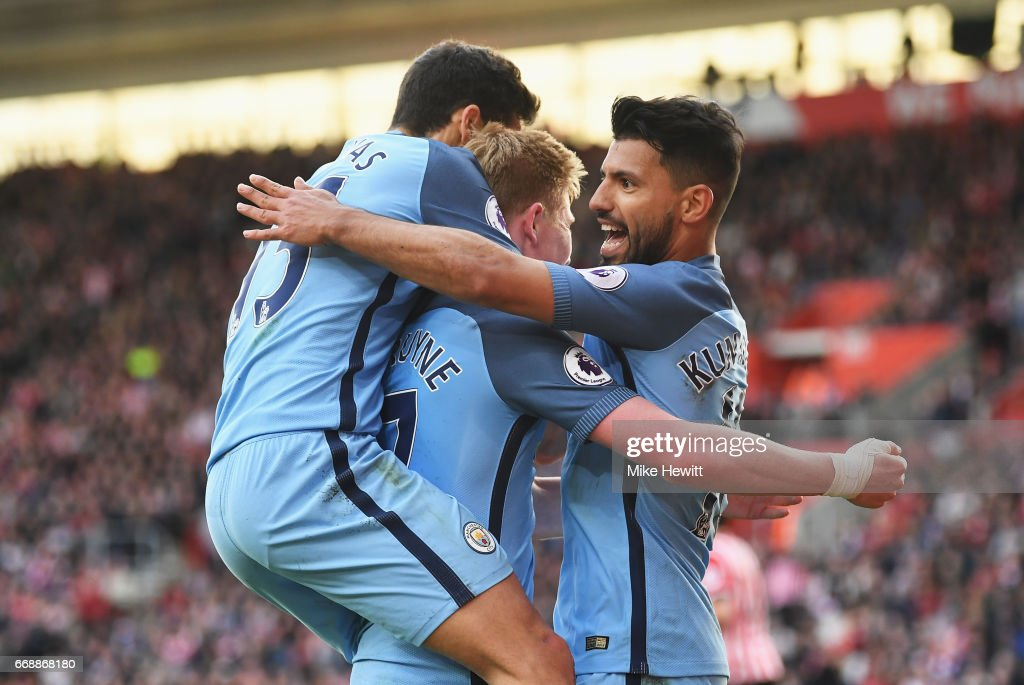 Sergio Aguero of Manchester City celebrates scoring his sides third goal with Kevin De Bruyne of Manchester City and Jesus Navas of Manchester City during the Premier League match between Southampton and Manchester City at St Mary's Stadium on April 15, 2017 in Southampton, England.