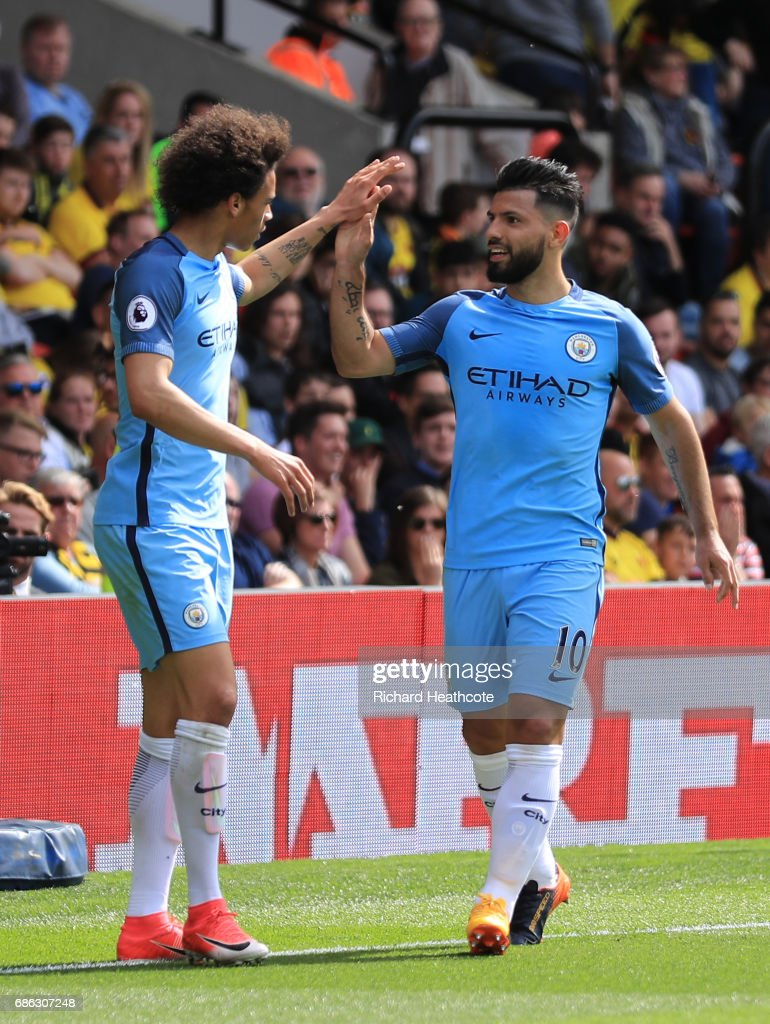Sergio Aguero of Manchester City celebrates scoring his sides third goal with Leroy Sane of Manchester City during the Premier League match between Watford and Manchester City at Vicarage Road on May 21, 2017 in Watford, England.