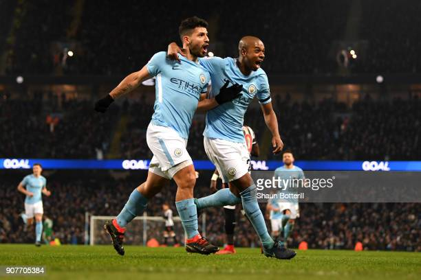 Sergio Aguero of Manchester City celebrates scoring his side's third goal with Fernandinho during the Premier League match between Manchester City...