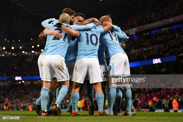 Sergio Aguero of Manchester City celebrates scoring his side's third goal with team mates during the Premier League match between Manchester City and...
