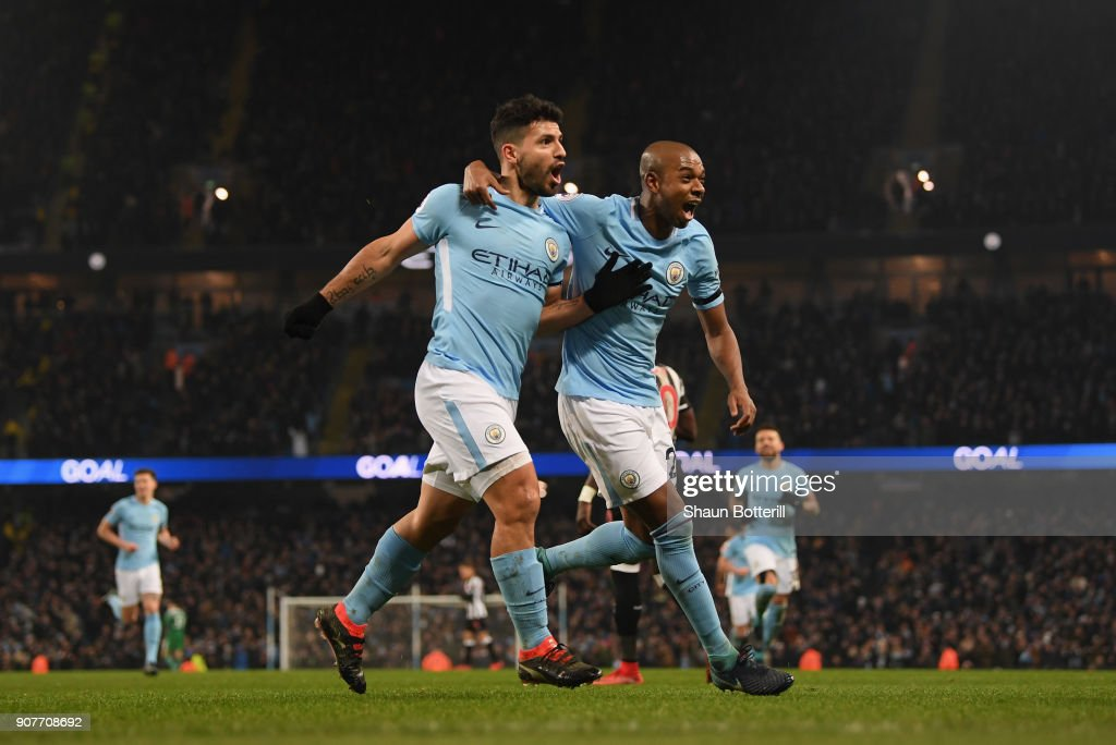Sergio Aguero of Manchester City celebrates scoring his side's third goal with Fernandinho during the Premier League match between Manchester City and Newcastle United at Etihad Stadium on January 20, 2018 in Manchester, England.