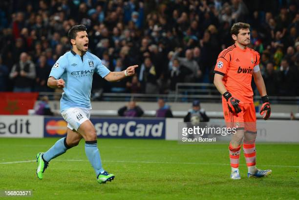 Sergio Aguero of Manchester City celebrates scoring his team's first goal from a penalty to make the score 11 during the UEFA Champions League Group...