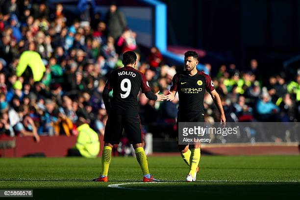 Sergio Aguero of Manchester City celebrates scoring his team's first goal with his team mate Nolito during the Premier League match between Burnley...